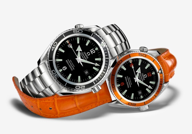 The Omega Seamaster Planet Ocean has a stainless-steel case available in two sizes: 45.5mm and 42mm.The dial has applied hour markers with SuperLuminova inserts and 12, 6 and 9 Arabic numerals, with a date window at 3 o'clock. The watch's distinctive look is provided by its grooved, unidirectional rotating bezel, the aluminium ring of which has two zones: the inner third in bare brushed aluminium and the outer two-thirds in black or orange. In addition to a stainless-steel bracelet with foldover safety clasp, a rubber strap and leather bracelet are also available (the latter in orange for the orange bezel and dark brown for the black bezel). The Omega calibre 2500 Co-Axial Escapement movement provides the timekeeping functions, which are displayed by luminous facetted arrowhead hour and minute hands. The unique Co-Axial movement has a power reserve of 48 hours and an intricate rhodium-plated finish of Geneva wave décor and circular graining. The Omega Seamaster Planet Ocean is water resistant to 600 metres / 2000 feet.